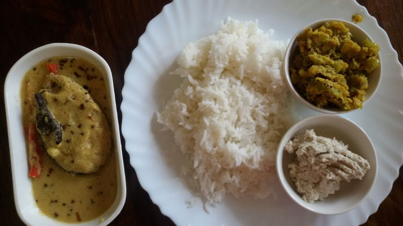 Rice, Fish Curry, Padavalanga Paripp Thoran  (pigeon pea _Snake Gourd with Grated Coconut ) and Mango Chutney