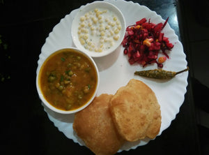 Aloo Mutter Sabji, Poori, Mix veg Raita and Suji ka Halwa and Pickle