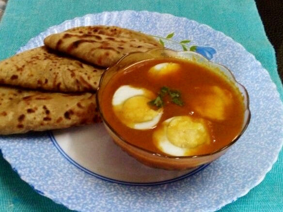 Egg Curry (2 Eggs) with Laccha Paratha (2) Rice Salad and Surprise Sweet