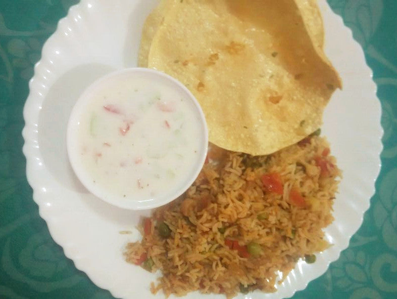 Veg Pulav with Raita and papad