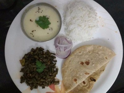 Chawli Bhaji (dry), Gujrati Kadhi, Chapati(4), Rice and Salad