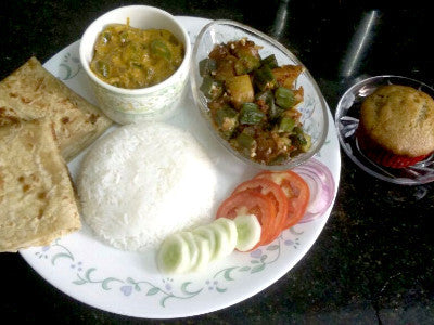 Capsicum Masala Curry, Potatoes & Lady Finger Sabji (dry), Plain Paratha, Steam Rice, Pickle, Salad & Apple Banana Eggless Muffin