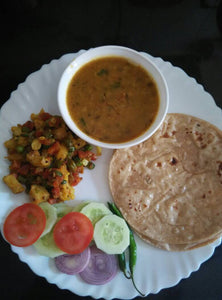 Veg Thali : Mixed Veg Sabzi, Dal, Rice, Roti, Papad, Salad & Surprise Dessert