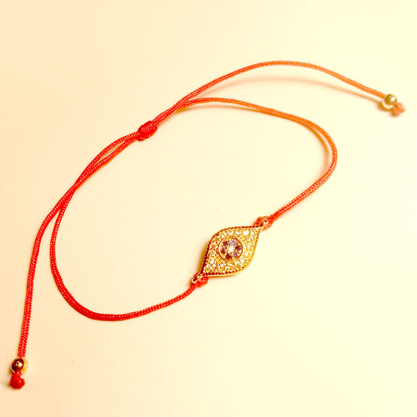 Delicate Red String Bracelet with Tiny Blue Sapphire-colored czs Yellow Gold-tone Evil Eye
