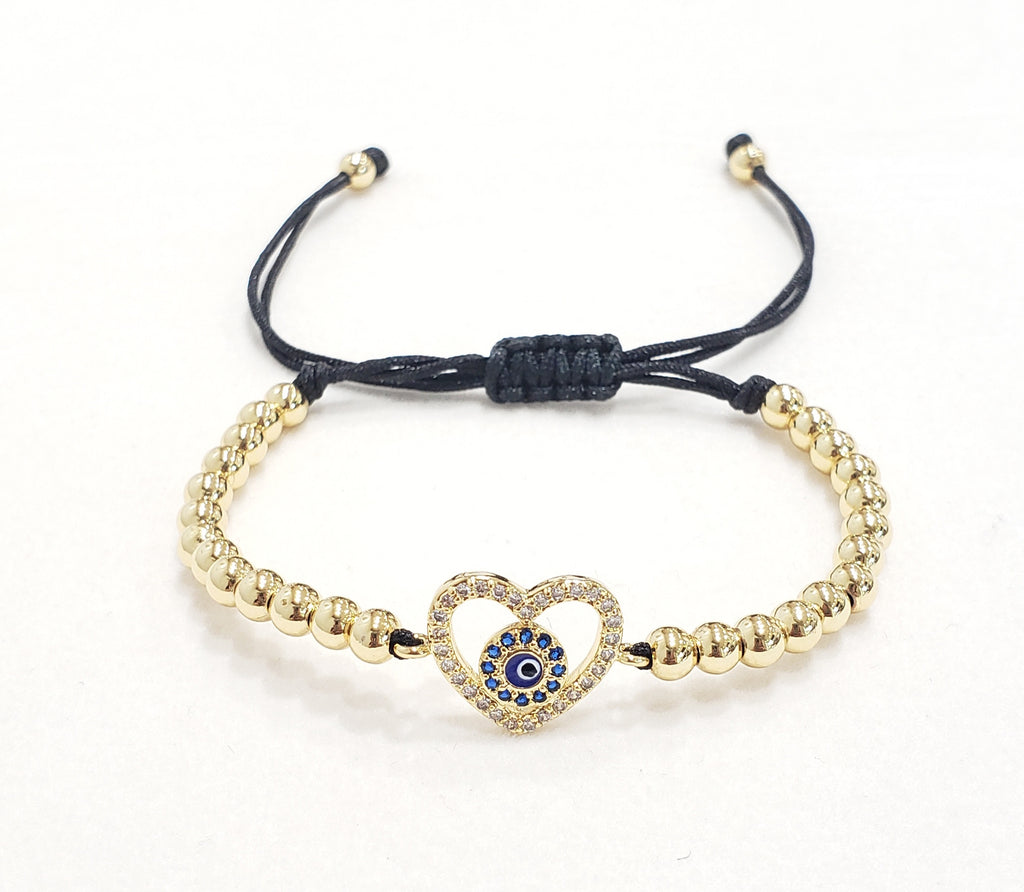 Evil eye with gold heart