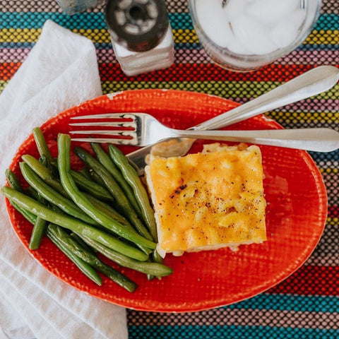 Mac and cheese with green beans on a red plate by Eat Smart RVA