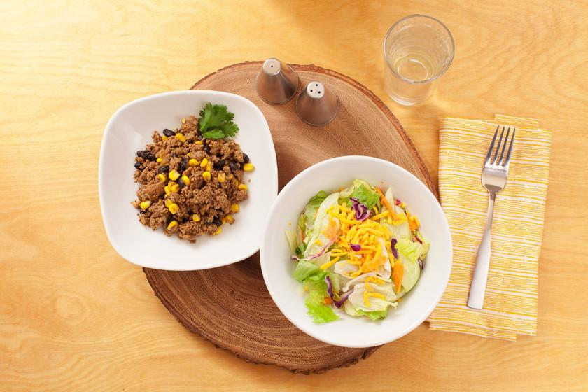 A salad bowl and bean bowl on a round place mat Eat Smart Richmond VA meal delivery service