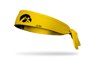 gold headband with University of Iowa tigerhawk logo in black