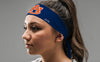 navy headband with Auburn University A U logo in orange and white on female