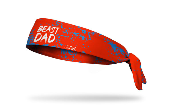 red headband with random blue paint strokes and Beast Dad wordmark in white