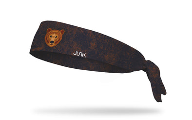 black and brown print headband with geometric bear in center