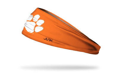 orange headband with Clemson University paw print logo in white