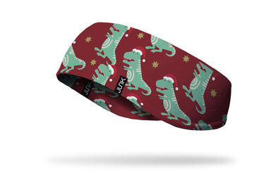 dinosaur in santa hat red ear warmer left side