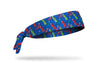 royal blue headband with colorful purple green red and blue cartoon dinosaurs design