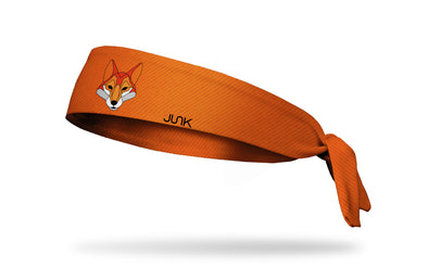 orange lined print headband with geometric fox in center