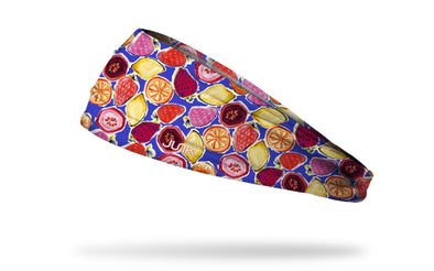 brightly colored headband with repeating hand drawn oranges, strawberries, lemons, and pomegranates