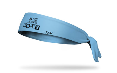 light blue headband with I am Going Crazy newspaper cutout wording front center
