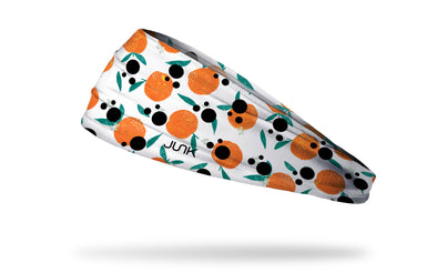 white headband with hand drawn oranges and a repeating ink blot pattern overlay