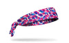 white headband with pink and blue paint smudge pattern