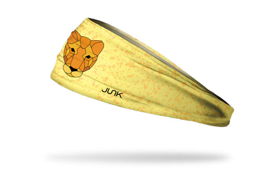 yellow smudge print headband with geometric lioness in center