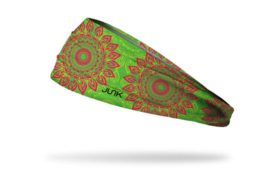 bright green JUNK headband with oversized repeating red mandala design