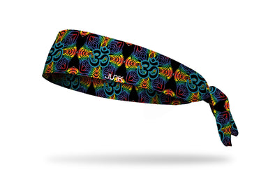 intricate mandala like design in black outlined in rainbow colors headband with om symbol in center