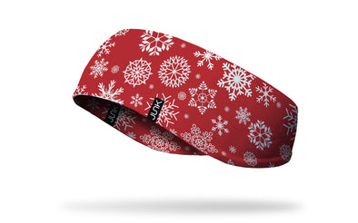 white snowflakes on red ear warmer left side