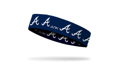 navy blue headband with Atlanta Braves repeating script A logo in white