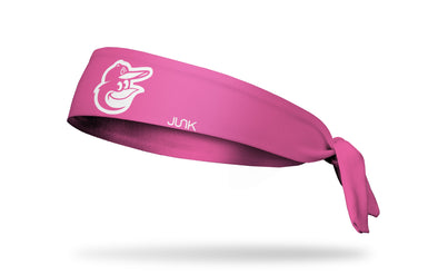 Pink headband with baltimore orioles logo in pink