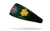 green headband with gold shamrock to right of Chicago Cubs logo