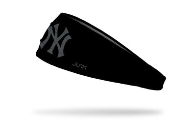 black headband with New York Yankees logo in grey / gray