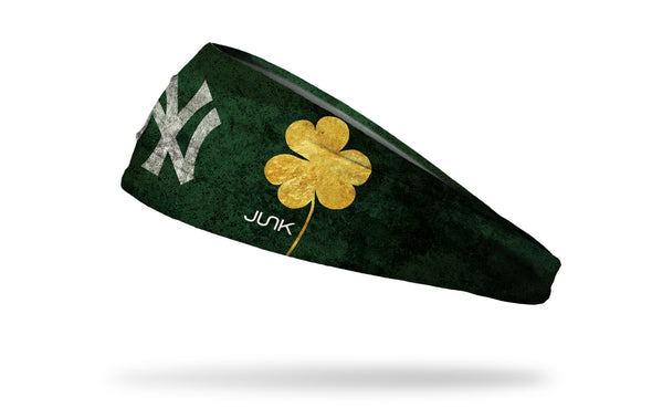 green headband with gold shamrock to right of New York Yankees logo