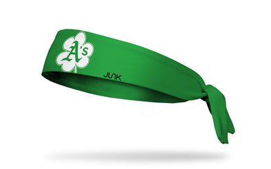 green headband with Oakland Athletics logo on white shamrock
