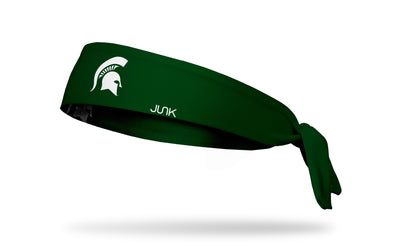 green headband with Michigan State University spartan logo in white