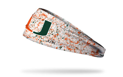 University of Miami white headband with orange and green paint splatter