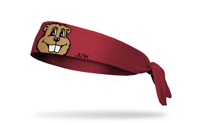 Maroon headband with University of Minnesota mascot Goldy oversized face view in full color