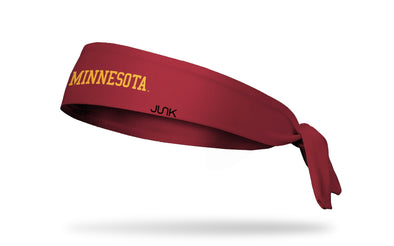 maroon headband with University of Minnesota Minnesota wordmark in gold