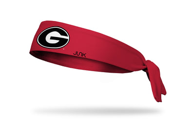 red headband with University of Georgia G logo in black and white
