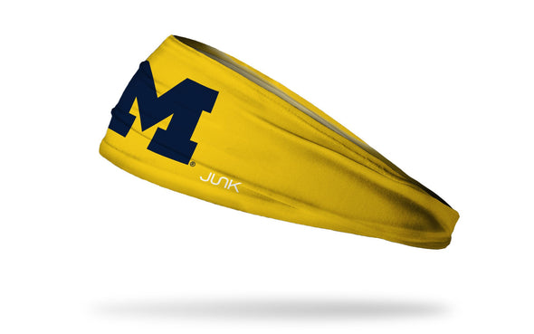 gold headband with University of Michigan M logo in navy