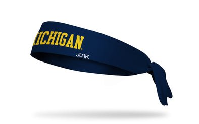 navy headband with University of Michigan Michigan wordmark logo in gold