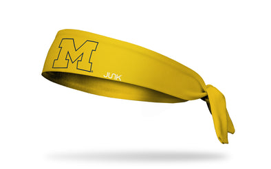 gold headband with University of Michigan M logo in gold with navy outline