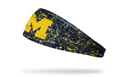 blue headband with paint splatter and University of Michigan logo