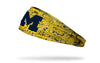 yellow gold headband with paint splatter and University of Michigan logo