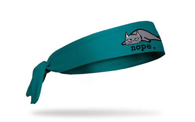 cat themed headband with a grey tired cat and the wordmark nope.