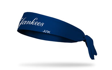 navy headband with New York Yankees cursive Yankees wordmark in white