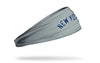 grey headband with New York Yankees New York wordmark logo in navy