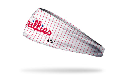 white headband with red pinstripes and Philadelphia Phillies wordmark logo in red and blue script