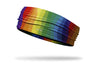 rainbow themed headband with red green blue indigo and violet wavy stripes