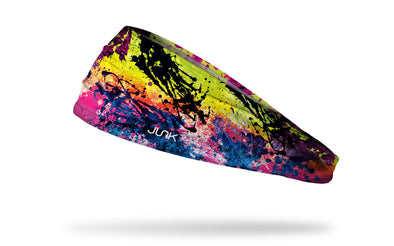 orange headband with pink black splatter like sun bursts