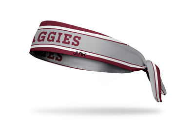 maroon and light grey headband with white varsity stripes and Texas A&M University Aggies wordmark in maroon